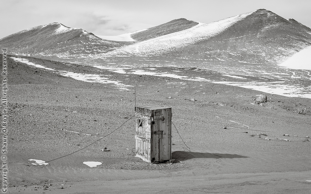 The telephone booth, actually an old dynamite shack used when dive holes were blasted through the sea ice at New Harbor. Now all holes are melted with a heater and kept open with chain saws and a lot of back work.