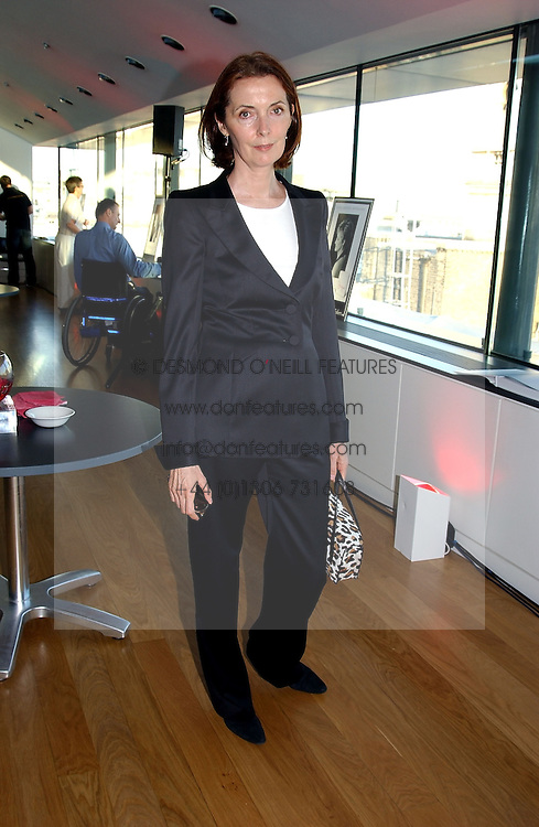 Fashion designer CATHERINE WALKER at a party to celebrate the UK launch of Diana:The Portrait, the authorised book about the late Princess Of Wales's life and work, held at the National Portrait Gallery, London on 1st September 2004.  The book was commissioned by The Diana, Princess of Wales Memorial Fund and writen by Ros Coward.