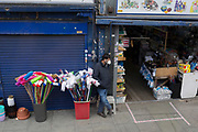 "The UK Chancellor Rishi Sunak has said it is ""very likely"" the UK is in a ""significant recession"" due to the Coronavirus pandemic lockdown, as figures show the economy contracting at the fastest pace since the financial crisis. And in the face of continued lockdown on the high street such as here on the Walworth Road in south London, a shop keeper waits for customers at his hardwear shop, on 13th May 2020, in London, England."