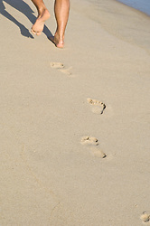 Man leaving his foot prints in the sand