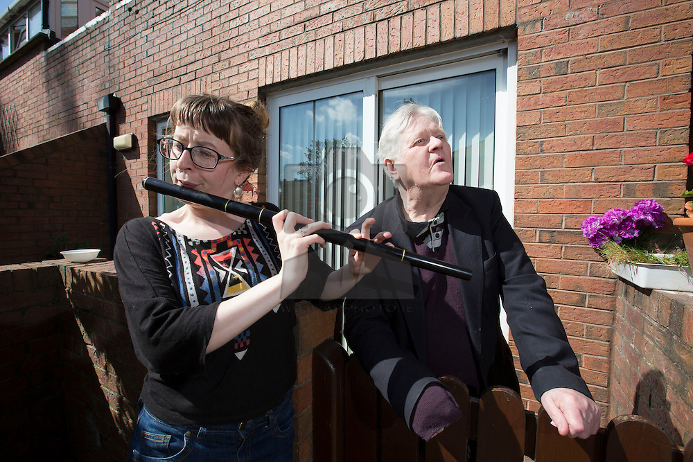 Sarah Lyons of Novartis plays along with Paddy Quinn singing as Novartis volunteers show off their hidden talents and entertain ALONE residents with music, jigs and reels at ALONE's Willie Bermingham premises in Dublin as part of the company's global Community Partnership Day. The initiative encourages staff to lend their time and support to local community organisations in need of volunteers, such as ALONE. ALONE is an independent charity that provides vital support to the one in 10 older people who are in need. Picture Andres Poveda