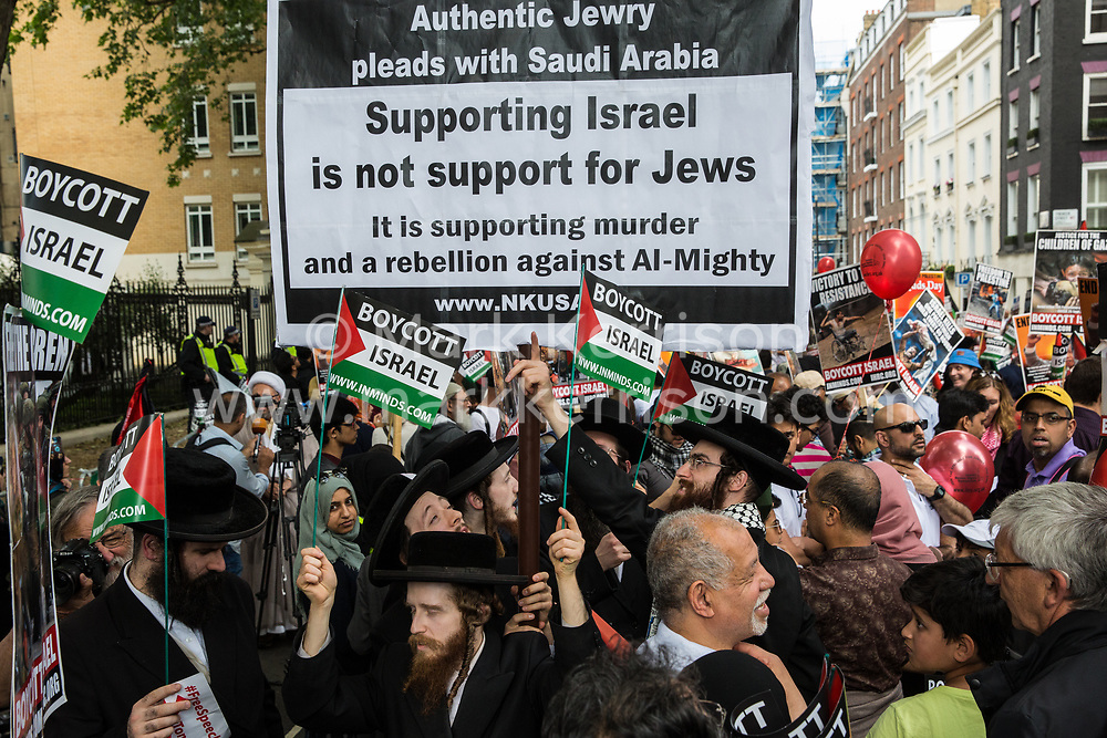 London, UK. 10th June, 2018. Orthodox Haredi Jews from Neturei Karta wait outside the Saudi embassy to take part in the pro-Palestinian Al Quds Day march through central London organised by the Islamic Human Rights Commission. An international event, it began in Iran in 1979. Quds is the Arabic name for Jerusalem.