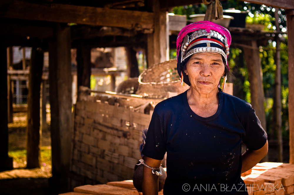 Laos, Muang Sing. A woman from the Akha tribe wearing a beautiful headdress. She lives in a small village situated in Muang Sing area.
