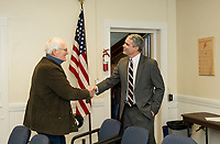 Mr. Witham congratulates Laconia's new Superintendent Steve Tucker as he enters the SAU building on Friday afternoon.  (Karen Bobotas/for the Laconia Daily Sun)