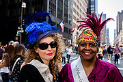 New York, NY - April 16, 2017. Two women from The Milliners Guild wearing stunning hats at New York's annual Easter Bonnet Parade and Festival on Fifth Avenue.