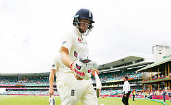 England's Joe Root walks off at lunch during day five of the Ashes Test match at Sydney Cricket Ground.