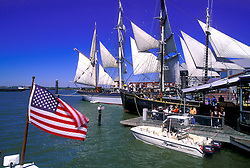 Smaller boats docked around the historic ship The Elissa in Galveston Texas