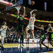 Nov 23  2018 Las Vegas, NV  U.S.A.  Texas forward Dylan Osetkowski (21) drives to the basket during the NCAA Men's Basketball Continental Tire Las Vegas Invitational between Texas Longhorns and the Michigan State Spartans 68-78 lost at The Orleans Arena Las Vegas, NV. Thurman James / CSM