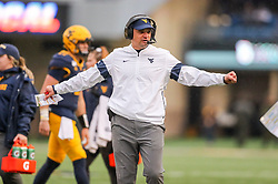 Nov 23, 2019; Morgantown, WV, USA; West Virginia Mountaineers head coach Neal Brown calls a timeout during the fourth quarter against the Oklahoma State Cowboys at Mountaineer Field at Milan Puskar Stadium. Mandatory Credit: Ben Queen-USA TODAY Sports