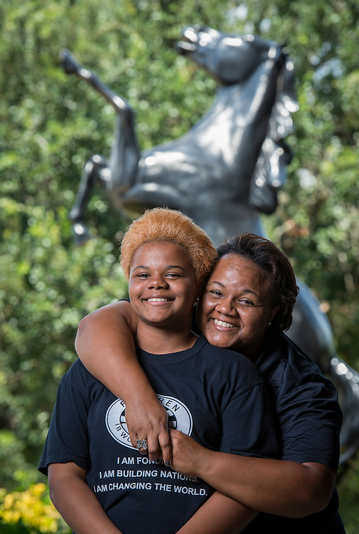 Tamokia Thompson, right, poses for a photograph with her daughter, Cienna Alley, left, at Fondren Middle School, September 9, 2014.