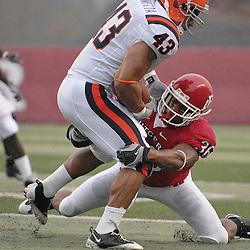 Nov 8, 2008; Piscataway, NJ, USA; Rutgers cornerback Courtney Greene (36) tackles Syracuse full back  Tony Fiammetta during Rutgers' 35-17 victory at Rutgers Stadium.