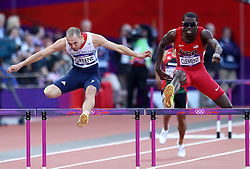 David Greene of Great Britain battles with Kerron Clement of The USA during the heats of the men's 400m Hurdles held at the Olympic Stadium in Olympic Park in London as part of the London 2012 Olympics on the 4th August 2012..Photo by Ron Gaunt/SPORTZPICS