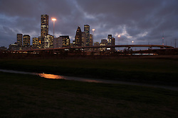 Houston, Texas skyline with bayou in foreground in the early evening.