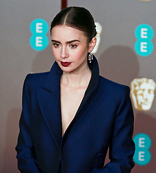 Lily Collins on the red carpet ahead of the 2019 British Academy Film Awards at the Royal Albert Hall in London, England on 10th Feburary 2019. ©Ben Booth/Edinburgh Elite media