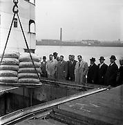 18/04/1962<br /> 04/18/1962<br /> 18 April 1962<br /> Irish sugar for USA<br /> A consignment of 1,600 tons of Irish beet sugar is loaded onto the S.S. Irish Elm at Dublin Docks on Wednesday, 18 April 1962. <br /> Left to right: Mr. Dermot Banner, director of Irish Shipping Ltd.; Mr. R.J. O'Hall Oran, assistant general manager, Irish Shipping Ltd.; Mr. Con Murphy, P.R.O., Irish Sugar Co.; Mr. Liam St. John Devlin, director, Irish Shipping Ltd.; Mr. Frank Robbins, director, Irish Shipping Ltd.; Mr. J.J. Stafford, chairman, Irish Shipping Ltd.; Mr. J.E. Mac Ellin, chairman, Irish Sugar Co.; and Capt. F.W. Kirk of the S.S. Irish Elm watching the loading of the sugar.