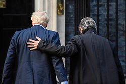 © Licensed to London News Pictures. 08/10/2019. LONDON, UK.  Boris Johnson, Prime Minister, (L) receives an arm around the shoulder from David Sassoli, President of the European Parliament, (R) who is visiting for talks at Number 10 Downing Street.  Photo credit: Stephen Chung/LNP