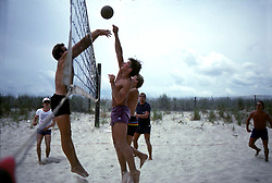 D. Ross Cameron 6/84<br /> <br /> Alexander D. Cameron (third from left) hits the ball over a defender during a game of beach volleyball at Deauville in Rehoboth Beach, Del.