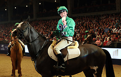 Frankie Dettori eats his birthday cake after he competes in the Markel Champions Challenge in aid of the Injured Jockeys Fundduring day four of the London International Horse Show at London Olympia.
