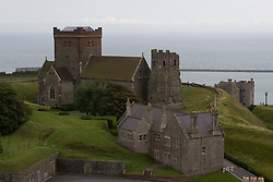 Dover/Kent/England - St. Mary in Castro & Roman Pharos and the English Channel as seen from Dover Castle. Dover is a major port on the south-east coast of England. Situated in the county of Kent, it faces France across the English Channel.