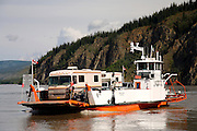 The auto ferry crossing the Yukon River bring visitors to the  historic gold rush town of Dawson City, Yukon Territory, Canada.