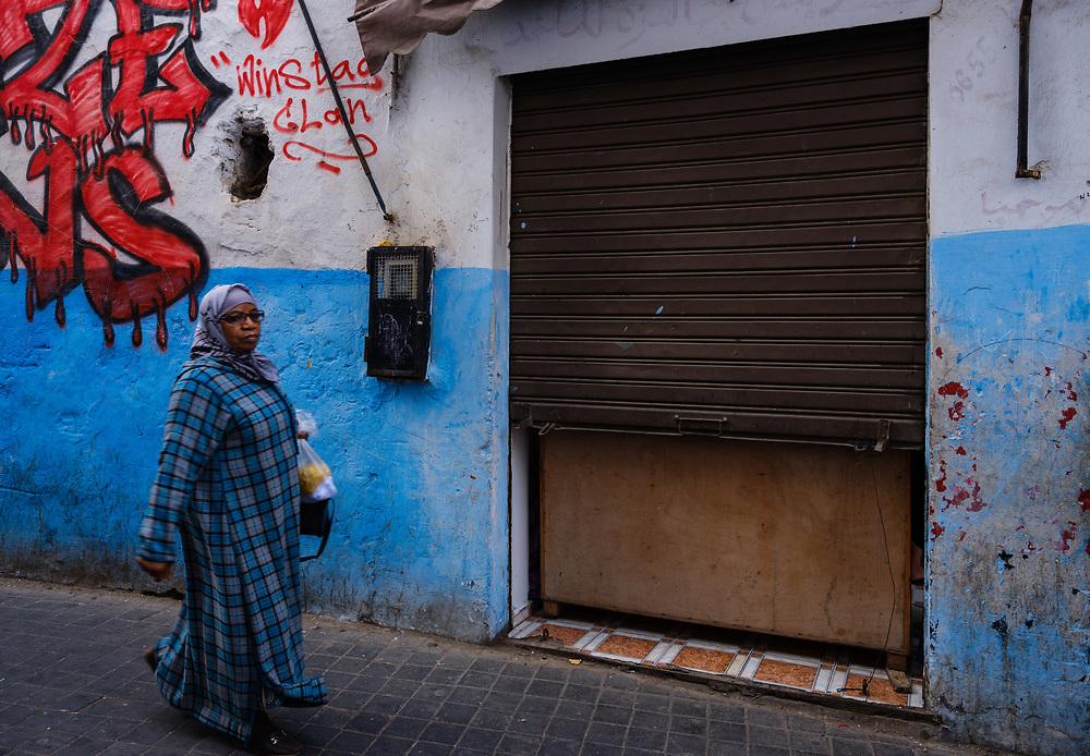 CASABLANCA, MOROCCO - CIRCA APRIL 2017: Muslim woman walking on an alleyway of the Medina in  Casablanca