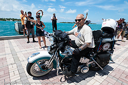Michael Cables riding his 1948 Harley-Davidson FL Panhead over the finish line of the Cross Country Chase motorcycle endurance run from Sault Sainte Marie, MI to Key West, FL. (for vintage bikes from 1930-1948). The Grand Finish in Key West's Mallory Square after the 110 mile Stage-10 ride from Miami to Key West, FL and after covering 2,368 miles of the Cross Country Chase. Sunday, September 15, 2019. Photography ©2019 Michael Lichter.