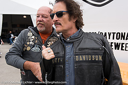 "Actor Kim Coates known for his roll as ""Tig"" on the Sons of Anarchy TV series with Fred Harwood of Pinellas Park, Fl during an autograph signing at the Harley-Davidson display at Daytona International Speedway on the first day of Daytona Beach Bike Week 2015. FL, USA. Saturday, March 7, 2015.  Photography ©2015 Michael Lichter."