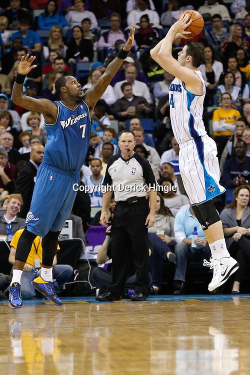 February 1, 2011; New Orleans, LA, USA; New Orleans Hornets power forward Jason Smith (14) shoots over Washington Wizards power forward Andray Blatche (7) during the second half at the New Orleans Arena. The Hornets defeated the Wizards 97-89.  Mandatory Credit: Derick E. Hingle