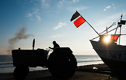 © Licensed to London News Pictures. <br /> 24/04/2015. <br /> <br /> Saltburn, United Kingdom<br /> <br /> Malcolm Jefferson drives down to launch his boat, Ellen, as he heads out to lay his lobster pots. Malcolm runs the last remaining commercial fishing boat out of Saltburn.<br /> <br /> <br /> Photo credit : Ian Forsyth/LNP
