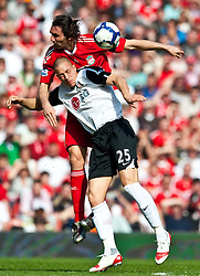 11.04.2010, Anfield, Liverpool, ENG, Premier League, FC Liverpool vs FC Fulham, im Bild Liverpool's Sotirios Kyrgiakos and Fulham's Bobby Zamora. EXPA Pictures © 2010, PhotoCredit: EXPA/ Propaganda/ D. Rawcliffe / SPORTIDA PHOTO AGENCY