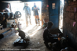 Denver Joe Hicks, Sean Lichter and Bear Haughton at a side of the road machine shop on day-4 of our Himalayan Heroes adventure riding from Pokhara to Kalopani, Nepal. Friday, November 9, 2018. Photography ©2018 Michael Lichter.