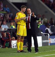 Photo: Chris Ratcliffe.<br /> PSV Eindhoven v Liverpool. UEFA Champions League, Group C. 12/09/2006.<br /> Rafael Benitez of Liverpool talks tactics to Steven Gerrard.