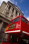 A nineties red London Routemaster bus on the number 11 route travels on Threadneedle Street, beneath the Bank of England in the Square Mile - the capitals financial district - on 21st June 1997, in the City of London, England.
