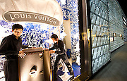 Louis Vuitton staff arrange the store's window display in the International Finance Center shopping mall, Luziajui, Pudong business district, Shanghai, China, on August 19, 2010. Photo by Lucas Schifres/Pictobank