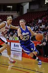 31 December 2009: Kristin Turk scoots past Katie Broadway. The Bulldogs of Drake fall to the Redbirds of Illinois State University by a score of 77-58in a Missouri Valley Conference game on Doug Collins Court in Redbird Arena in Normal Illinois.