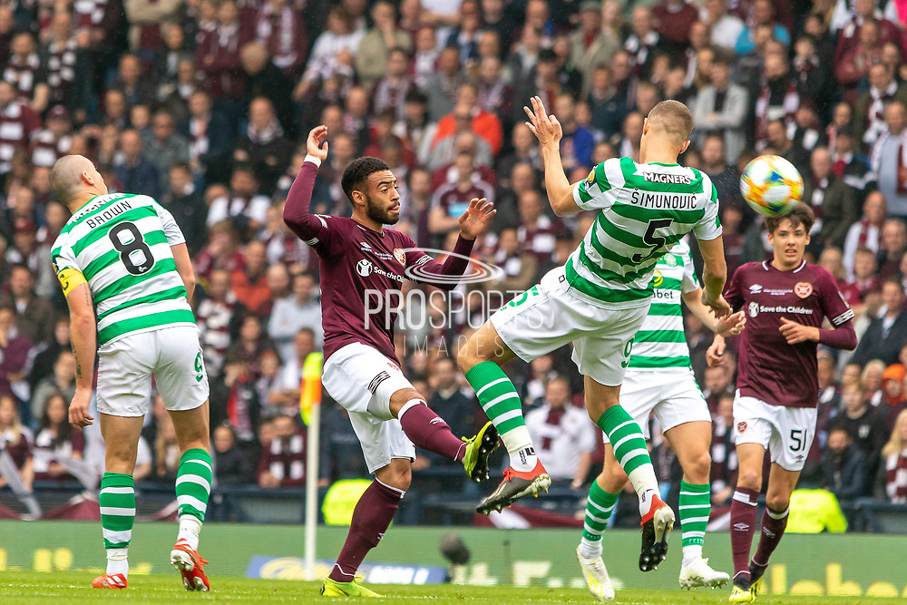 Jozo Simunovic of Celtic wins a header during the William Hill Scottish Cup Final match between Heart of Midlothian and Celtic at Hampden Park, Glasgow, United Kingdom on 25 May 2019.