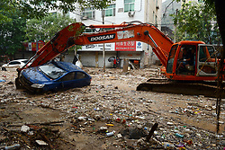 July 27, 2017 - A bulldozer cleans the site after a flood in Suide County of Yulin City, northwest China's Shaanxi Province. Rescue work continues in the worst-hit Suide and Zizhou counties after a torrential rain caused a flood in the city.  (Credit Image: © Qi Xiaojun/Xinhua via ZUMA Wire)