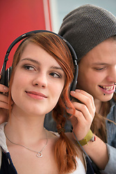 Young couple listening to music, Munich, Bavaria, Germany