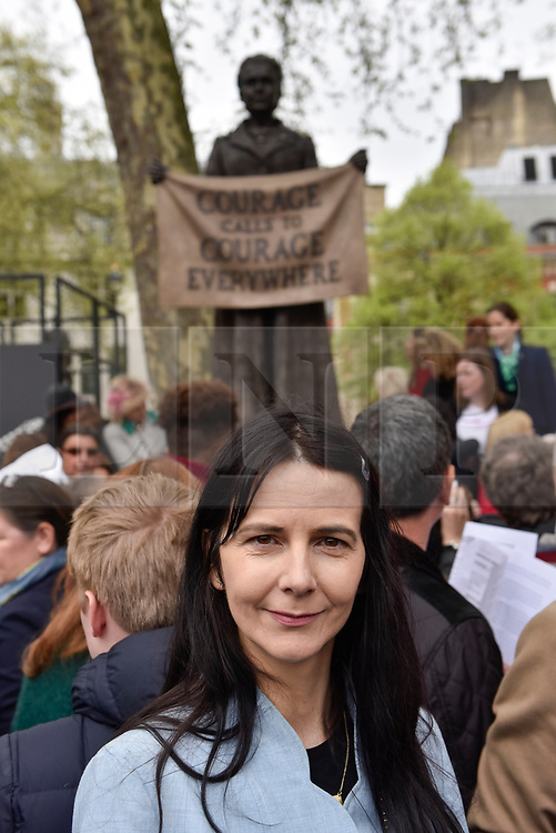 "© Licensed to London News Pictures. 24/04/2018. LONDON, UK. Artist Gillian Wearing poses at the unveiling of a statue of suffragist Millicent Fawcett in Parliament Square.  The bronze casting, created by artist Gillian Wearing, shows a banner reading the text ""courage call to courage everywhere"", is the first statue of a woman to be erected in Parliament Square and was commissioned as part of this year's centenary of the 1918 Representation of the People Act, giving some women aged over 30 the right to vote.  Photo credit: Stephen Chung/LNP"