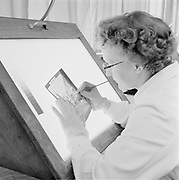 Woman retouching lithographic film on a light board, Finland 1958