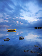 A Yellow Dinghy Floats On The Stormy Blue Where Sky Meets Sea, Composite Image, Digital Art