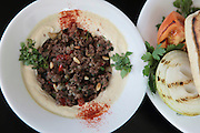 Hummus and lamb served with pitta and pickles