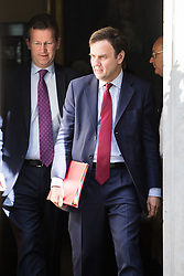 Downing Street, London, April 12th 2016. Chief Secretary to the Treasury Greg Hands is followed by Attorney General Jeremy Wright as they leave the weekly cabinet meeting. <br /> ©Paul Davey<br /> FOR LICENCING CONTACT: Paul Davey +44 (0) 7966 016 296 paul@pauldaveycreative.co.uk