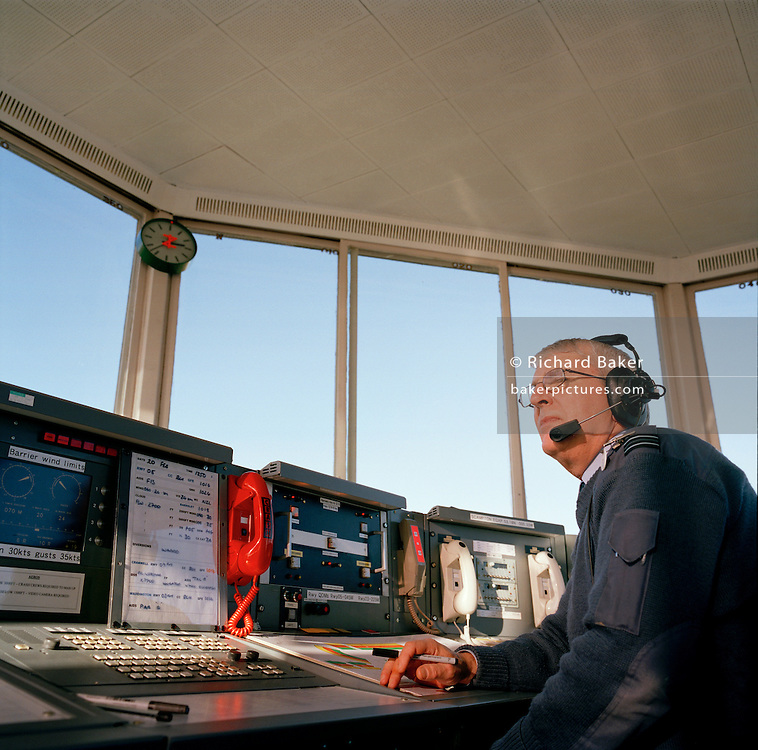 Air traffic controller in control tower at RAF Scampton, home base of the 'Red Arrows', Britain's Royal Air Force aerobatic team