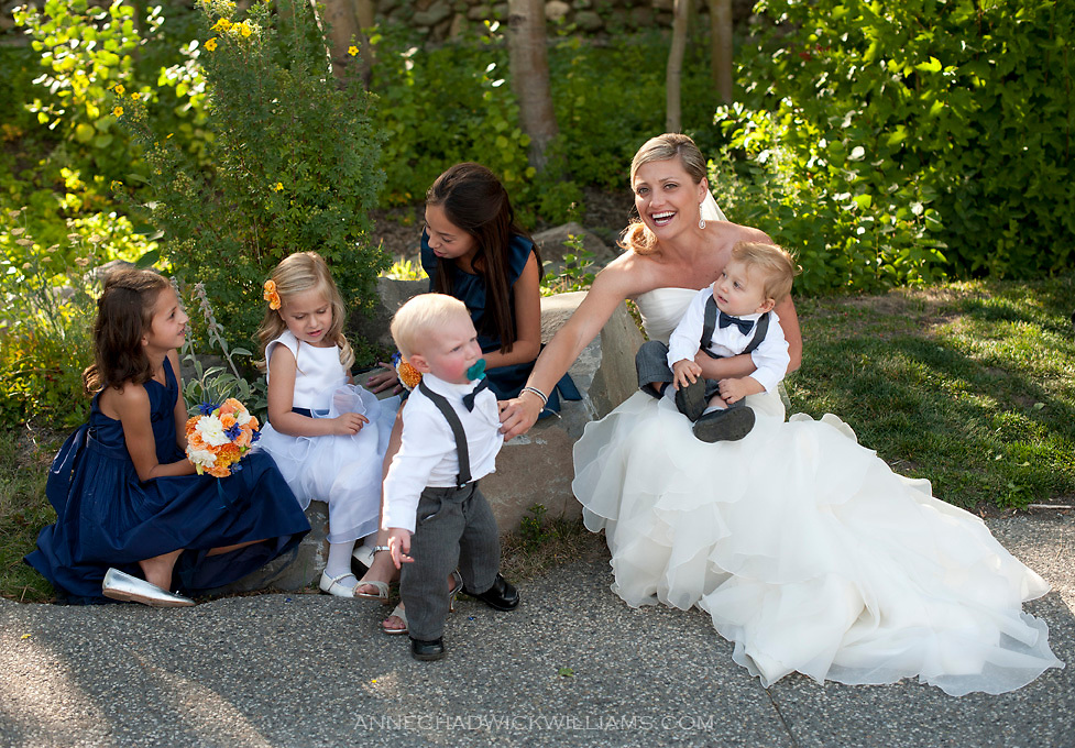 A bride with flower girls and boys at her wedding at Plumb Jack, Squaw Valley, Tahoe, California.