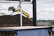 Caterpillar digger working on the construction site for the HS2 mainline station at Curzon Street on 3rd August 2020 in Birmingham, England, United Kingdom. The Curzon Street Masterplan covers a 141 hectare area of regeneration, focussed on HS2 Curzon Street station in Birmingham city centre, combined with approximately 700 million in investment into the surrounding area including new homes and commercial developments. High Speed 2 is a partly planned high speed railway in the United Kingdom with its first phase in the early stages of construction, the second phase is yet to receive full approval and the third is subject to merging with Northern Powerhouse Rail, a separate project.
