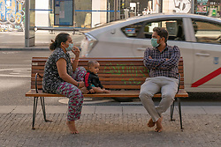 A family in the center of the city after the Spanish Government decree the State of Alarm in the country and the confinement of the population during the health crisis due to the Covid-19 virus pandemic - Coronaviruss. March 15,2020. Photo by Jesus Anton JAM/AlterPhotos/ABACAPRESS.COM