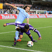 Mix Diskerud, NYCFC, challenges Darwin Ceren, Orlando, during the New York City FC Vs Orlando City, MSL regular season football match at Yankee Stadium, The Bronx, New York,  USA. 18th March 2016. Photo Tim Clayton