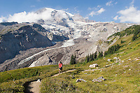Young man hiking in Mount Rainier National Park, WA