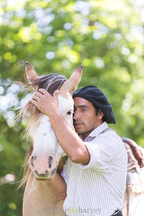 Gaucho talks to his horse, Estancia La Bamba De Areco, Pampas, Argentina, South America